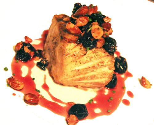 Bass with cherries and almonds.