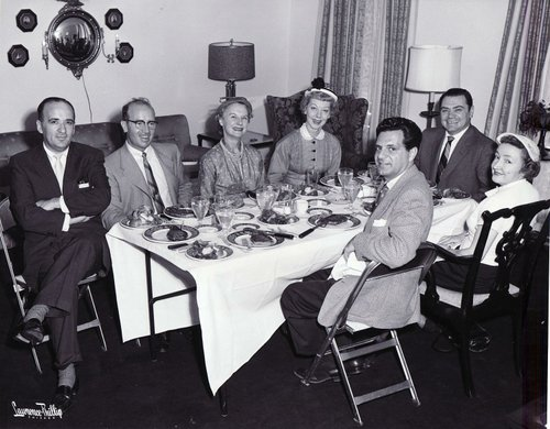 A 1956 candid of Ernie chowing down at the home of a Chicago journalist. Check out the size of those USDA plate-mates!
