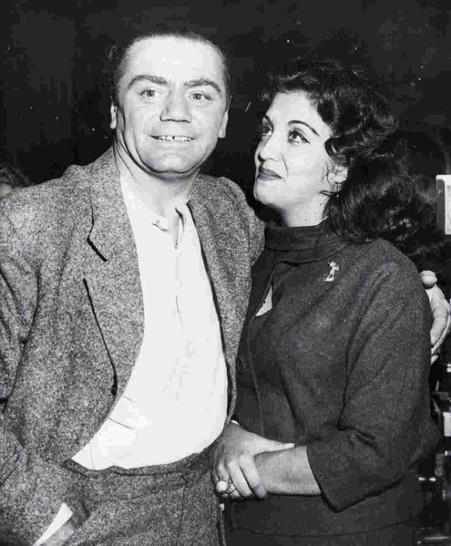 """HOLLYWOOD Dec. 9, 1959 – 'I SURE LOVE HEEM.' – Mexican actress Katy Jurado and actor Ernest Borgnine embrace as she joined him at the studio yesterday after flying here from her home in Cuernavaca, Mexico. She told newsmen she made the trip to find out when she and the Oscar-winning actor were going to marry. Borgnine explained he wants to make their home here, but she prefers Mexico. She invited those present at the reunion to 'look at that man. I sure love heem!'"""