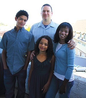 Delicia and husband Jerry with their son August and  daughter Zoe on their balcony overlooking Mission Bay.