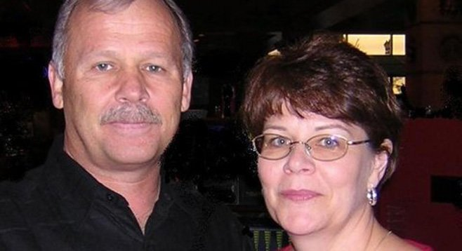 "Carl Baker (with his wife Susan) worries that churches are ""giving up their biblical values for political correctness."""
