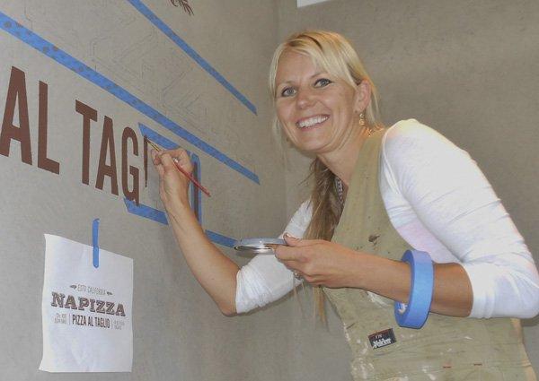 Edita Semiginovska paints the new signs
