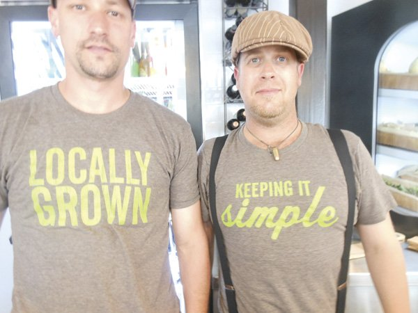 Signs — and shirts — promise local, organic ingredients.