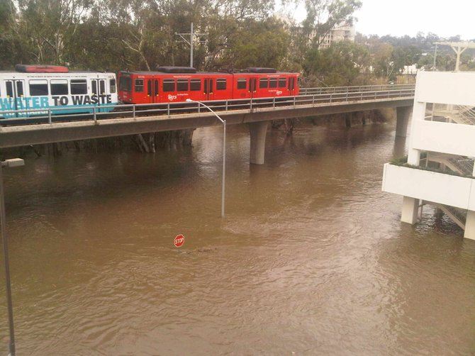 Remember when Fashion Valley flooded a few years back?  I was going through an old cell phone and found this in the pictures....pretty cool.  The trolley says No Water To Waste but in my pic it only captured Water to Waste....that happened to be up to the stop sign!!!!  Thought I would submit it.