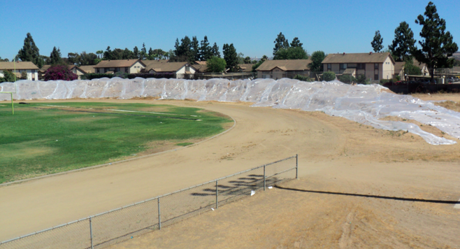 Origin of dirt (covered in plastic) at Southwest High is still under investigation