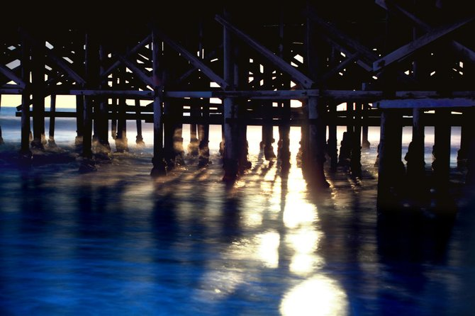 10 second exposure Under the pier in PB at sunset in July.