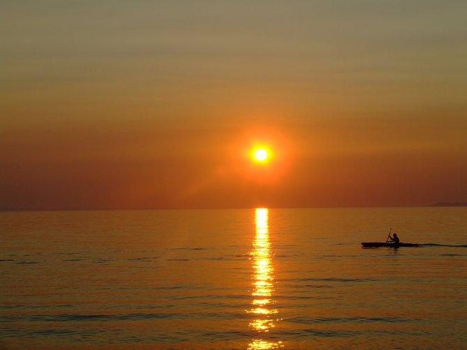 hazy summer sunset over Good Harbor Bay