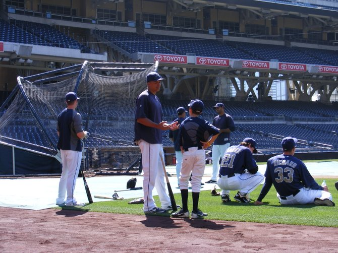 Will Venable explains some of the finer points of baseball to a youngster during Padres batting practice.