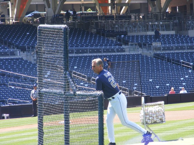 Padres manager Buddy Black throws batting practice.