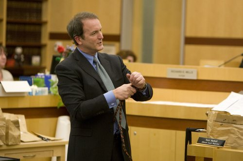 Defense atty Matthew Roberts demonstrates binding of the victims to jurors during trial.
