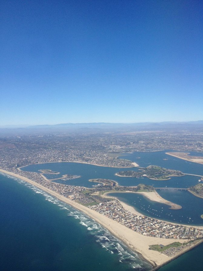 A Photo i took with my I-phone flying over San Diego Coast Line on a Beautiful Sunny Day! No Filter used or Edit, Just the Actual Picture Featured! Its Crazy How well I-Phones can take pictures or just how Noticeably Beautiful Our San Diego Coast Line is!