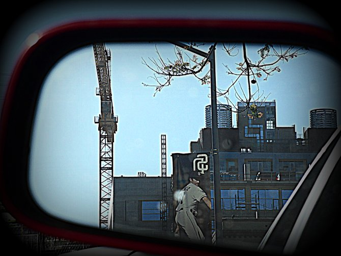Construction of the new San Diego library through my car sideview mirror.