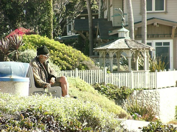 Man sitting on a bench in La Jolla. July 28, 2012.