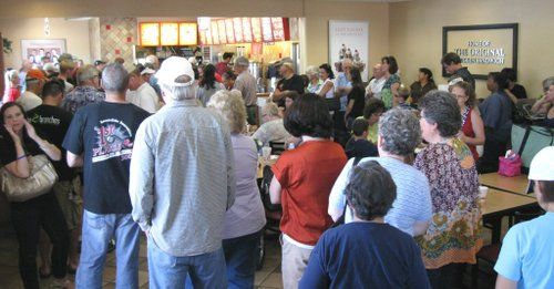 Evan though it was hot and crowded, customers were smiling and polite.  Photo Bob Weatherston.