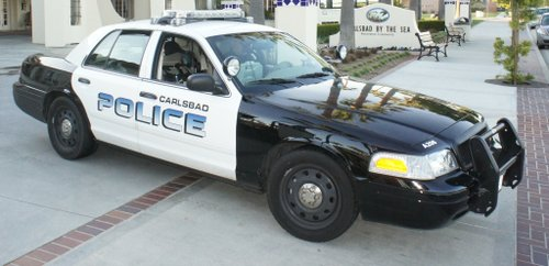 Carlsbad cop interrupted bag o'peanuts street brawl.  Photo Bob Weatherston.