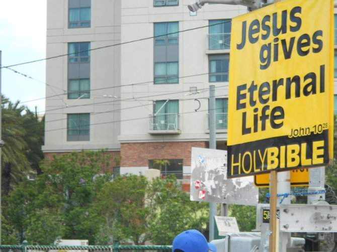 Comic-Con protest signs downtown.
