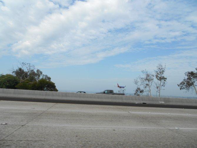 Southwest Airlines landing after descending over Interstate 5 downtown.