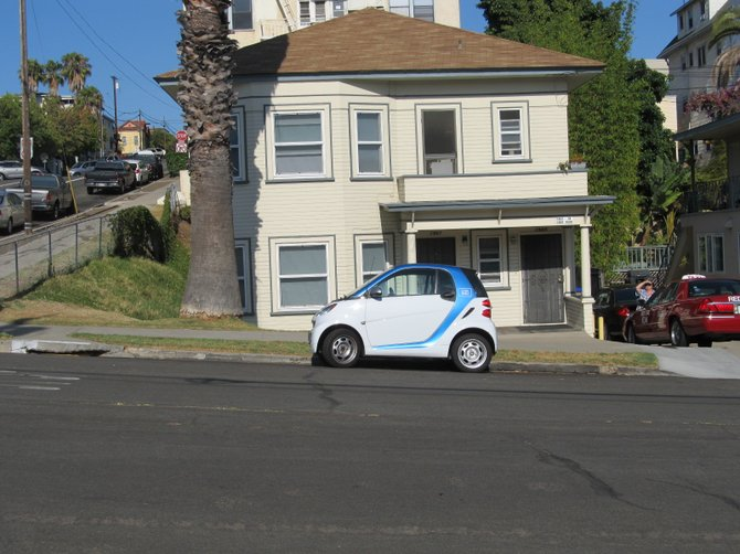 Nice parking A-hole. A car2go hogging up the two parking spaces in front of my house.
