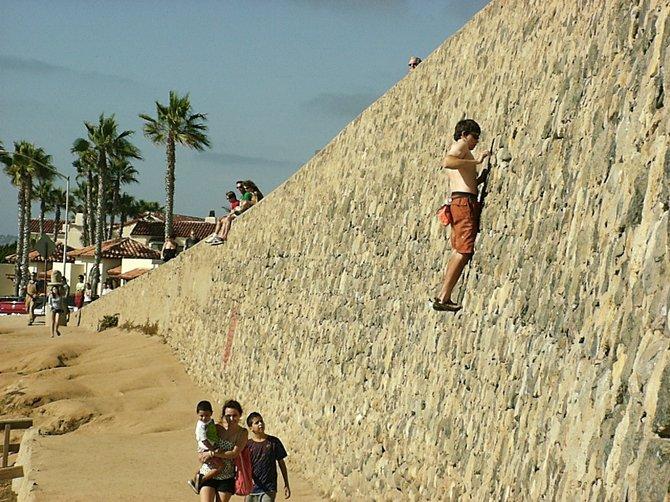 Dude climbing a wall in La Jolla, July 28, 2012.