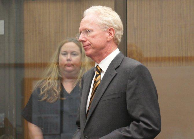 Julie Harper and defense attorney Paul Pfingst.  Photo Weatherston.