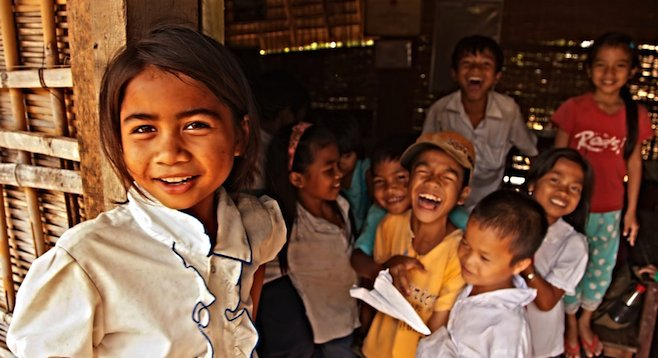 Meeting a group of Vietnamese schoolchildren in the Central Highlands town of Kon Tum.
