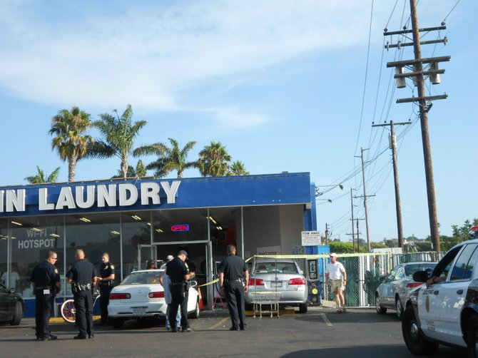 SDPD swarm the scene of a car crash into a Coin Laundry in the Midway District.