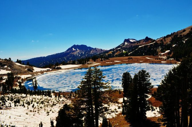 Lassen National Park, volcano lake with melting ice.