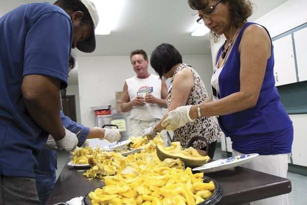 Cutting jackfruit at the California Rare Fruit Growers club meeting in Balboa Park