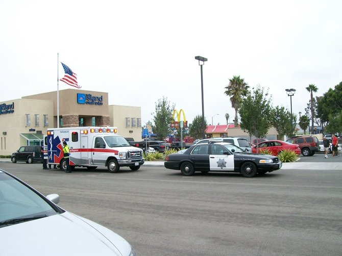 An Imperial Beach woman dragged and thrown to the ground by a car she tried to stop from fleeing a minor fender bender is transported by ambulance to the emergency room of a local hospital.