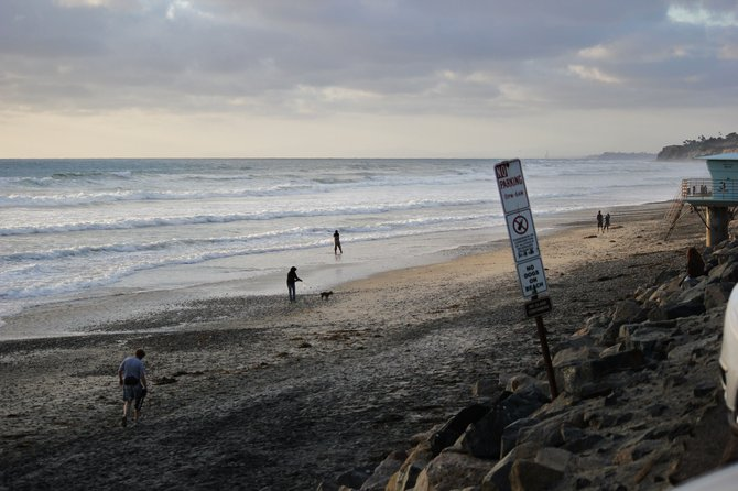 The story of six people and a dog whom can be seen in this photo.  What are their stories?  You can visit this beach near Del Mar and find out for yourself!  We visit this beach as much as possible during the hot summer days in the Imperial Valley.  Enjoy... Vilma