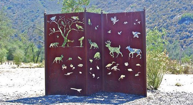 Fanciful fence welcomes visitors to the preserve