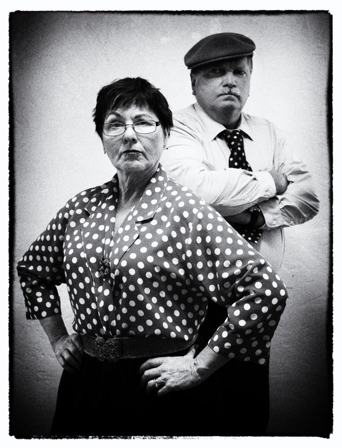 The loose-lipped Tax Collector (r, Doug Hoehn) and his wife (l, Gail West).  Photo: Josh Freeman