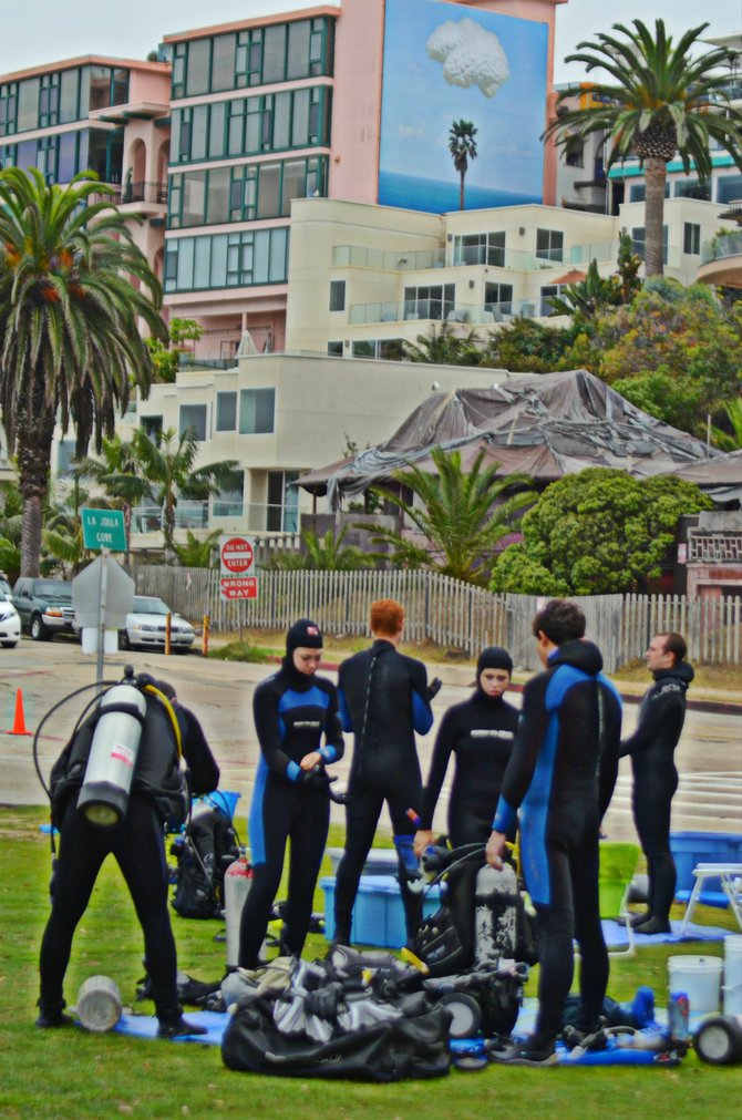 Divers gearing up to explore the waters at La Jolla Cove