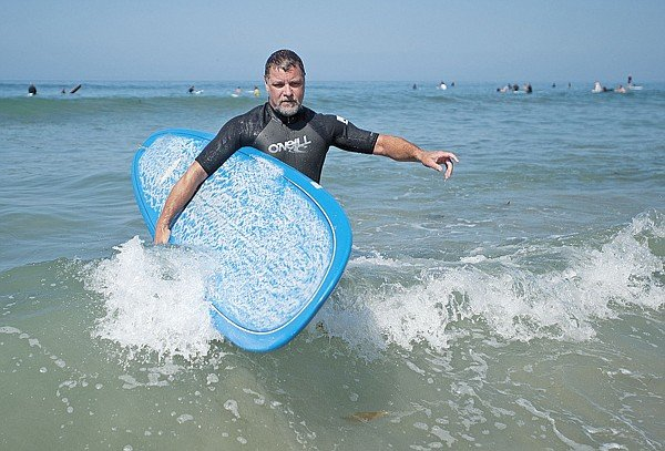 """Arnold Holmes gets out of the water and away from """"Those @#$%^* kite surfers!"""""""