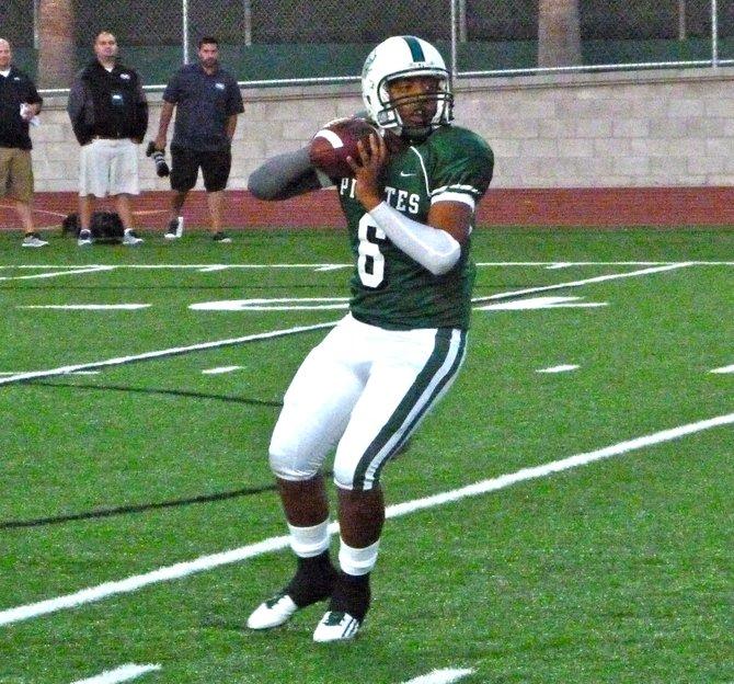 Oceanside senior quarterback Tofi Paopao is starting on varsity for the third straight season
