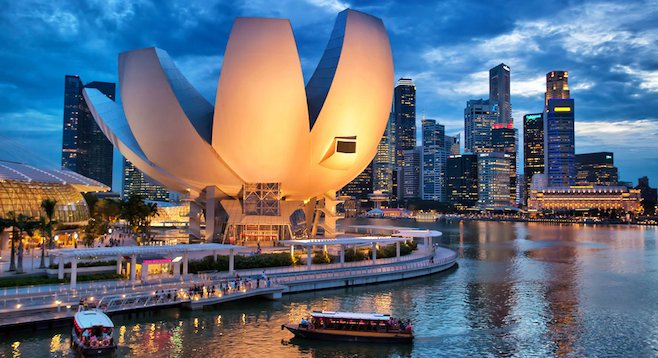 Singapore's extravagant ArtScience Museum on Marina Bay, downtown in the background.