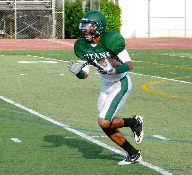 Poway senior defensive back Derek Babiash returns a kickoff during practice
