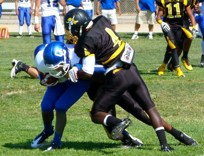 Mission Bay defensive back No. 4 wraps up an Orange Glen receiver