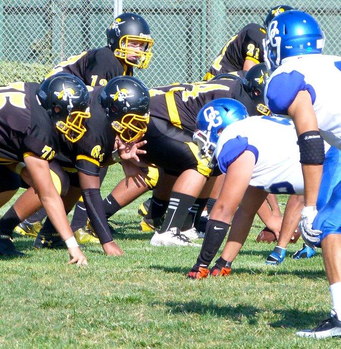 Mission Bay junior quarterback Nick Plum surveys the Orange Glen defense at the line of scrimmage