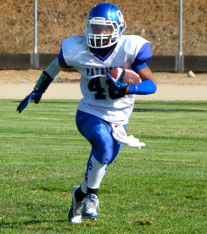 Orange Glen junior defensive back Adam Hernandez carries the ball upfield