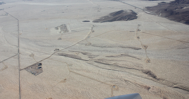 Roads and sites are a point of concern because they run east-west across the natural desert drainage