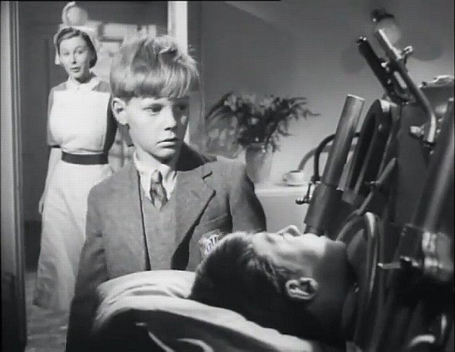 "Thea Gregson, James Fox, and Keith Robinson in Charles Frend's ""The Magnet"" (1950)."