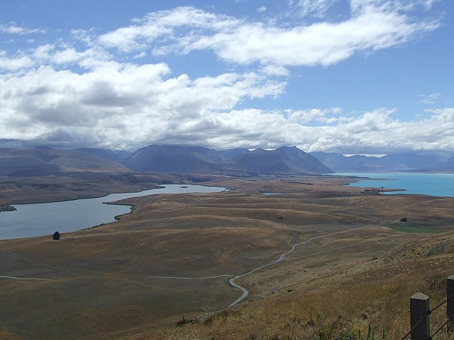 A Lake Tekapo panorama is a stark contrast in colors.