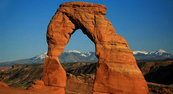 The widely recognized (and photographed) Delicate Arch frames Utah's La Sal Mountains 35 miles to the southeast.