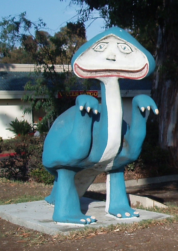 This is Rangui the blue Glarf. A Glarf is a cross between a dwarf and a dinosaur. The Glarfs were named and created by a 15 year old boy named Jerry Lee Gauss some time in the 1960's. Jerry died in a traffic accident at age 19. This Glarf, along with it's companion, Rumbi, the yellow Glarf, used to reside in the front yard of the Gauss family's home home on Valley Road in Bonita until they disappeared in 1970. They were found found again in 1993 and relocated to their current spot in front of the Bonita Village Shopping Center on Bonita Road in 1999.