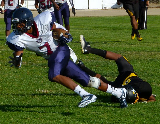 Horizon receiver Darren Carrington lunges forward after breaking free from a Mission Bay defender