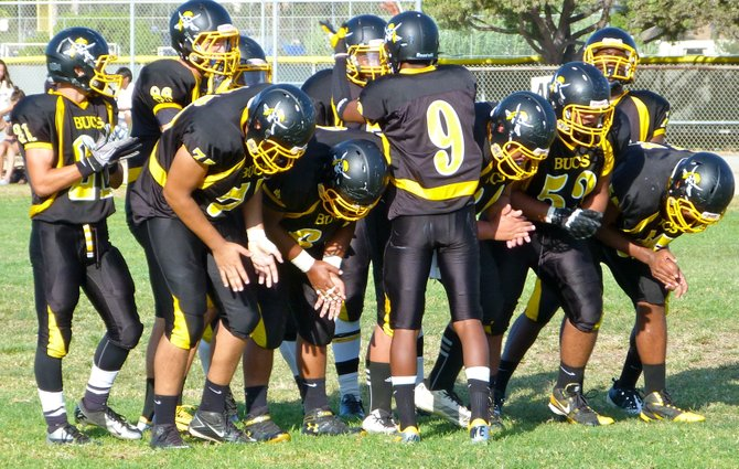 Mission Bay sophomore quarterback Devon Johnson calls out a play in the offensive huddle