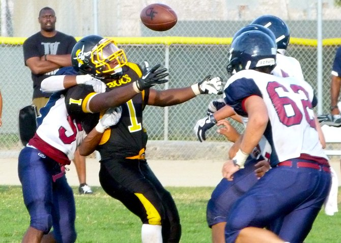 Mission Bay junior running back Devante Kinder watches as the ball flies loose between four Horizon defenders