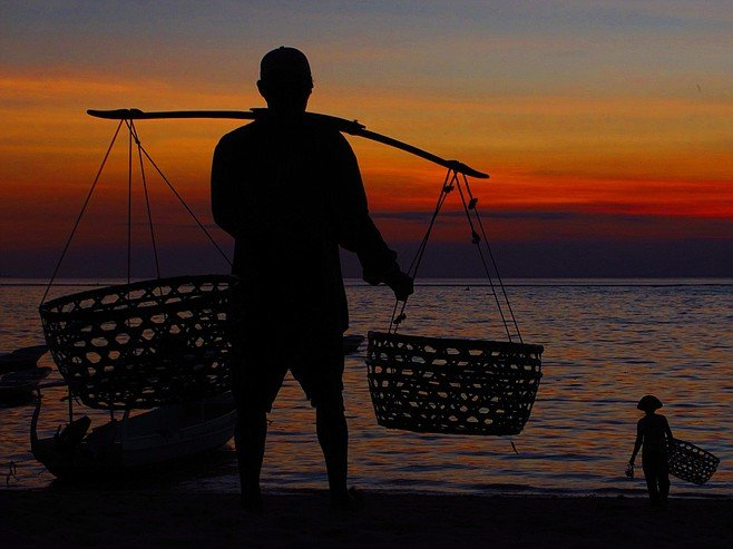 Seaweed farmer at sunset, Nusa Lembongan.