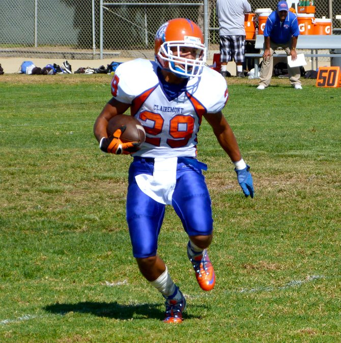 Clairemont senior running back Nick Espinoza carries the ball in space
